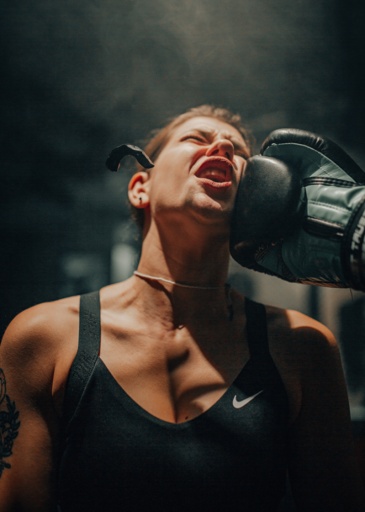 Female Boxer recieving un uppercut to the cheek or how no to improve brain function