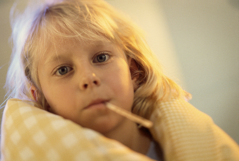 Young Child with a Thermometer in Mouth Early MS Brain Fog