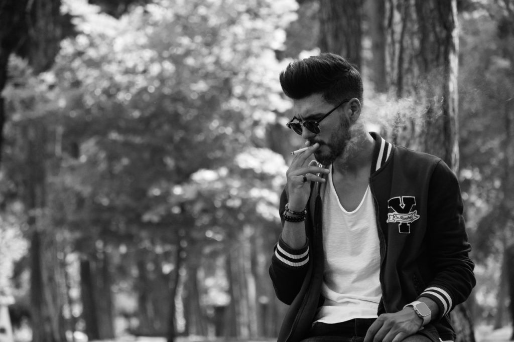 Young Man Puffing a Cigarette